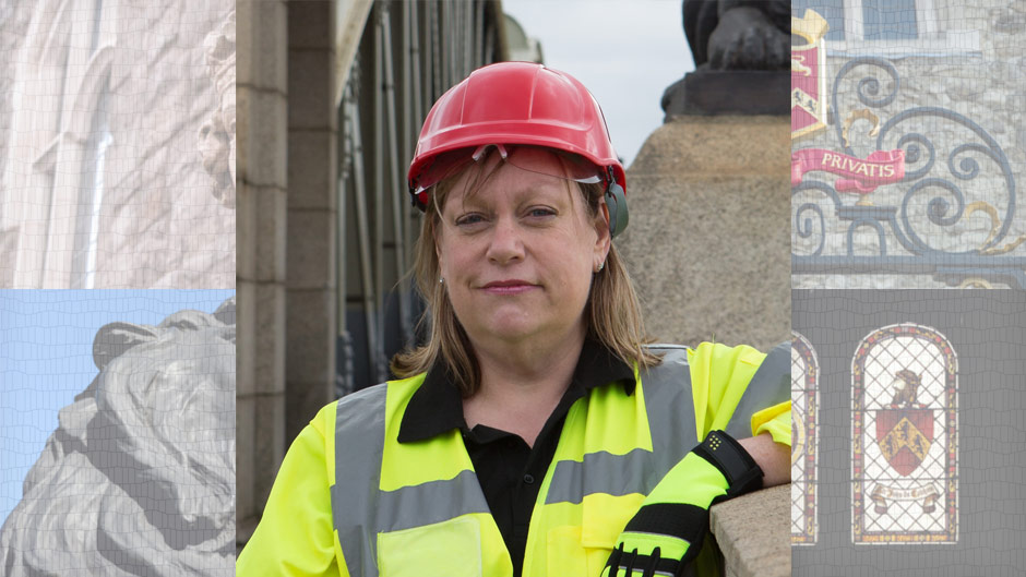 Woman in hard hat and hi-vi vest standing on a bridge